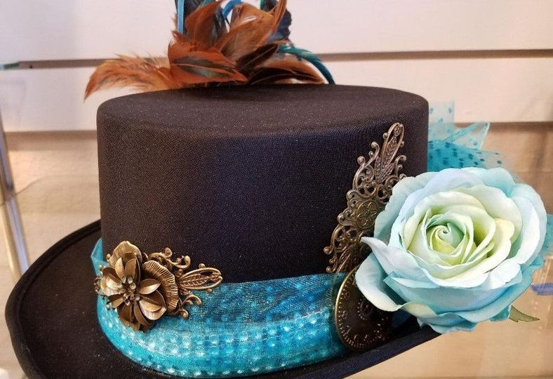 Black steampunk style hat with blue flower and accent. A veil can be attached at the back.