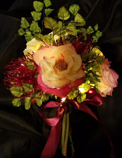 Burgundy ribbon and accents with yellow roses bouquet