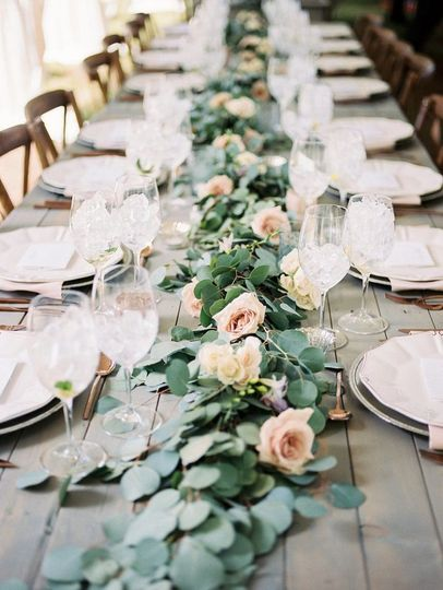 Table centerpiece of Eucalyptus garland  and pink roses