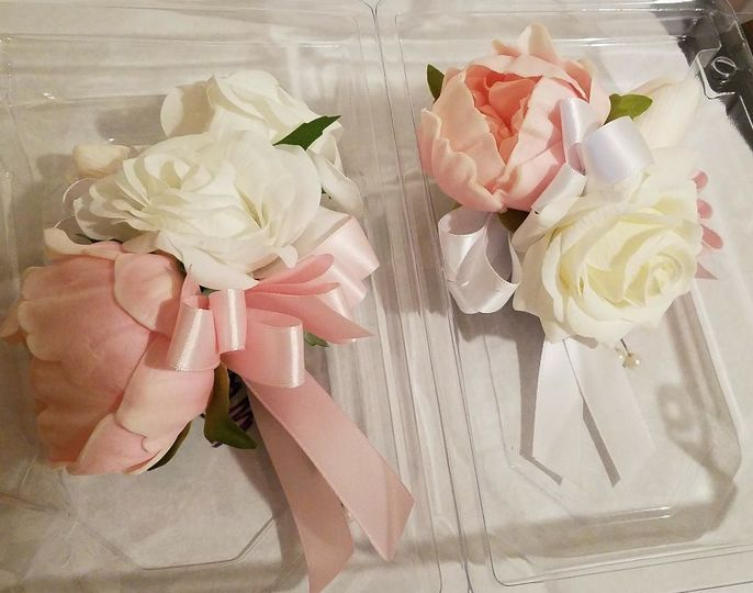 Pink peonies and white roses mother's of the bride and groom corsages