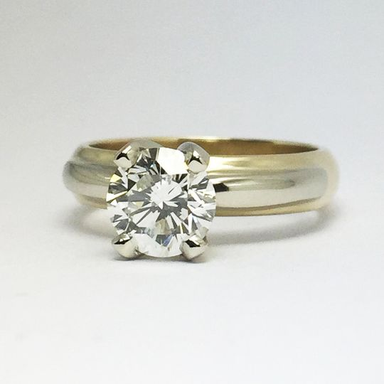 Custom creation by Craig-- Brilliant diamond solitaire in a two-tone gold ring.