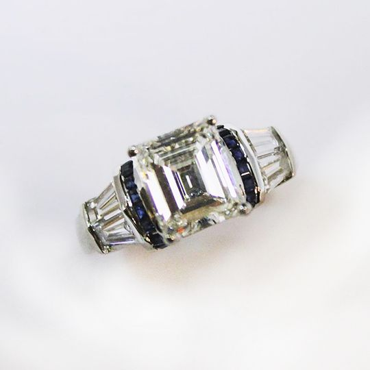 Custom creation by Craig-- Emerald-cut diamond with sapphires & diamond baguettes in a platinum...