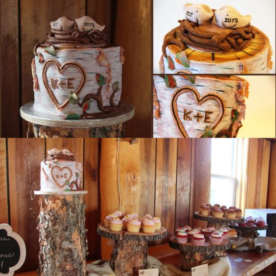 Birch stump cutting cake with hand-modeled birds in nest accompanied by 100 cupcakes decorated to...