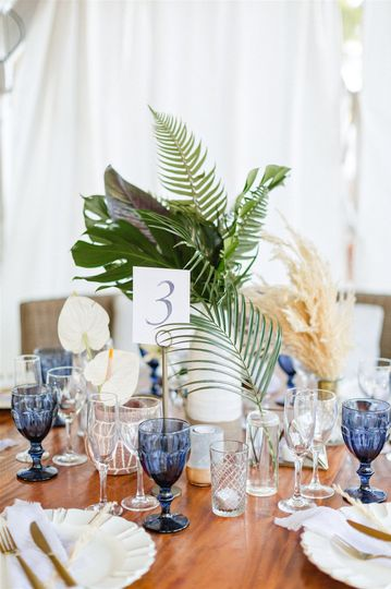 Greenery stems and blue glassware