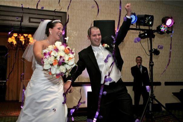 Dark purple streamer shots for wedding grand entrance