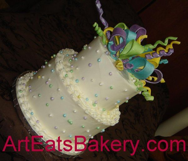 Tmx 1244409327831 Colorfulribbonsandpearlstwotierbuttercreamweddingcake Greenville wedding cake