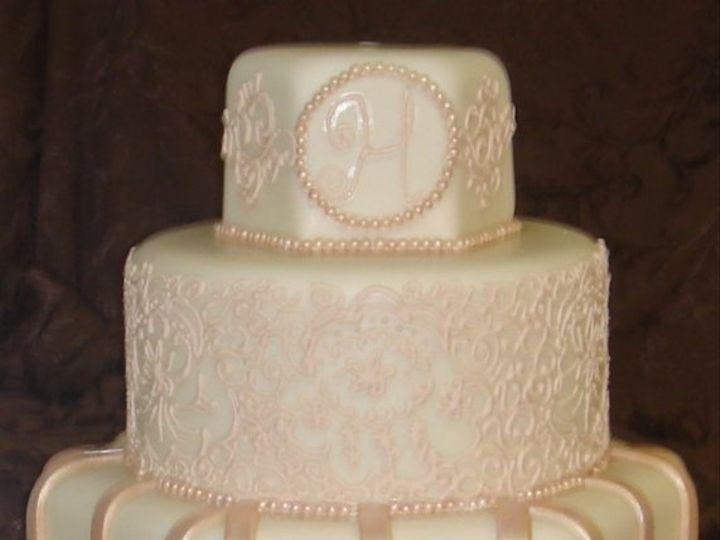 Tmx 1279494557687 Customroundandhexagonivoryandchampagnemonogramandlacefondantweddingcake Greenville wedding cake