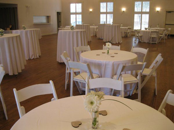 The couple rented and brought in white wooden folding chairs, high top tables and linens from Kirby...