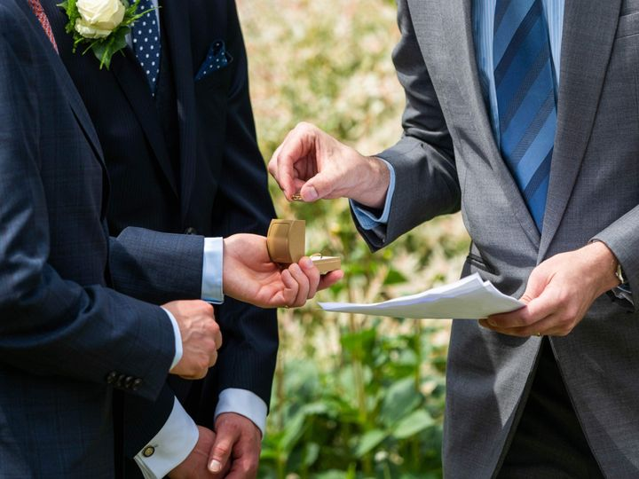Officiant examines ring