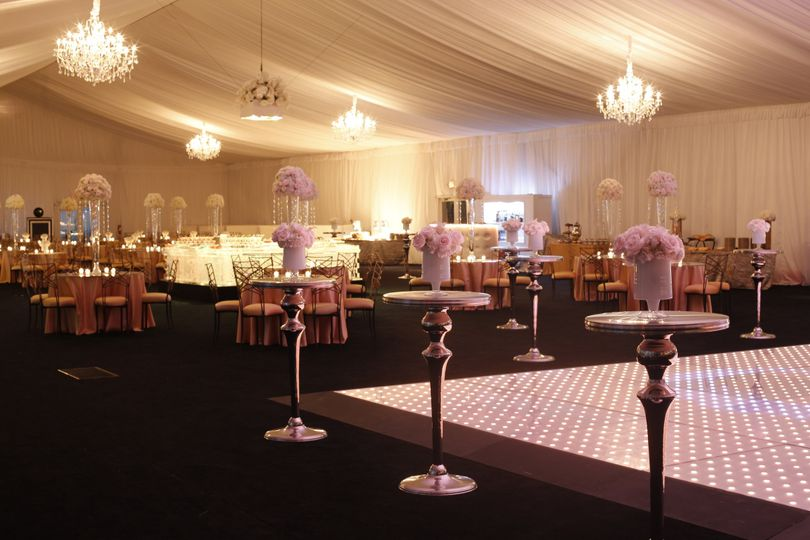 This luxury tent wedding is complete with pixel dance floor, mirrored highboys, lush floral, booth...