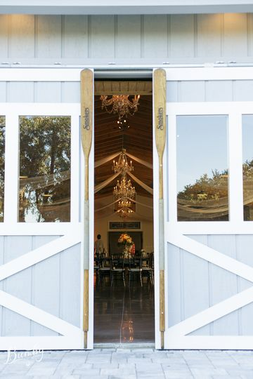 A peek inside the 6, 000sqft, air conditioned boathouse through the sliding barn doors