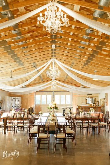 Farmhouse tables provided by crystal and crates set in a non-traditional style in the boathouse