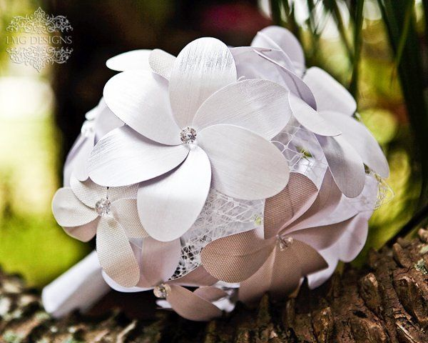 Why paper flowers?  They are affordable.  They can be kept for forever and don't have to have it...