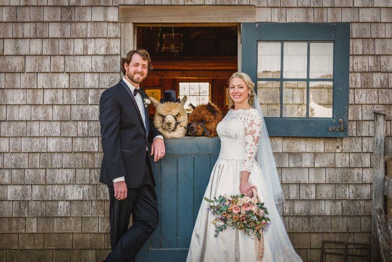 Happy couple with alpacas