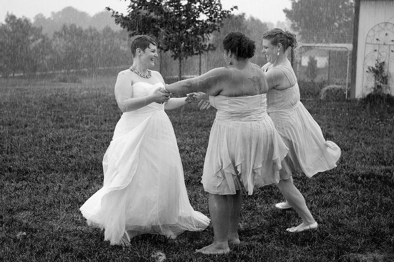 bridesmaids dancing rain columbus wedding photogra