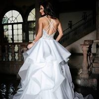 Backless and ruffled wedding dress