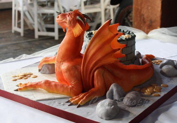 Hand sculpted dragon groom's cake