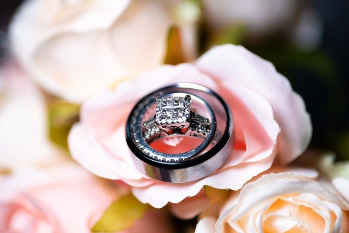 Wedding rings on delicate pink roses