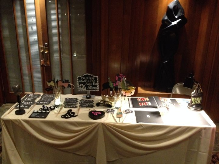 View of the table. Includes signing area and hand held props.