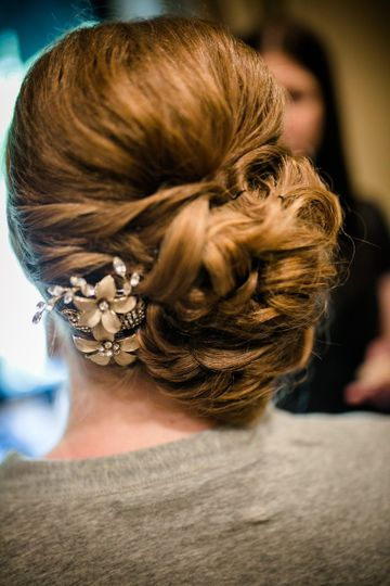 Curled low bun with gold flower ornament
