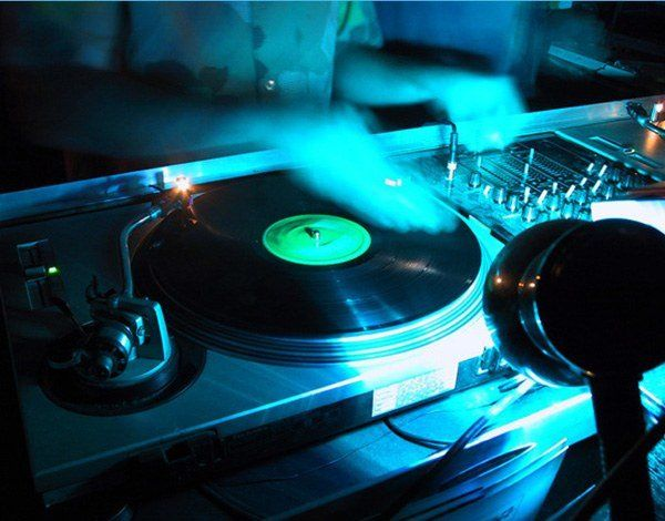 Scratching on the turntables.  Many of the DJs at Dash Entertainment us real vinyl or CD turntables...