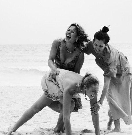 girls having fun at a beach wedding