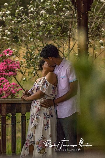 Couple kissing in a park