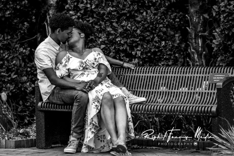 Kissing on a park bench