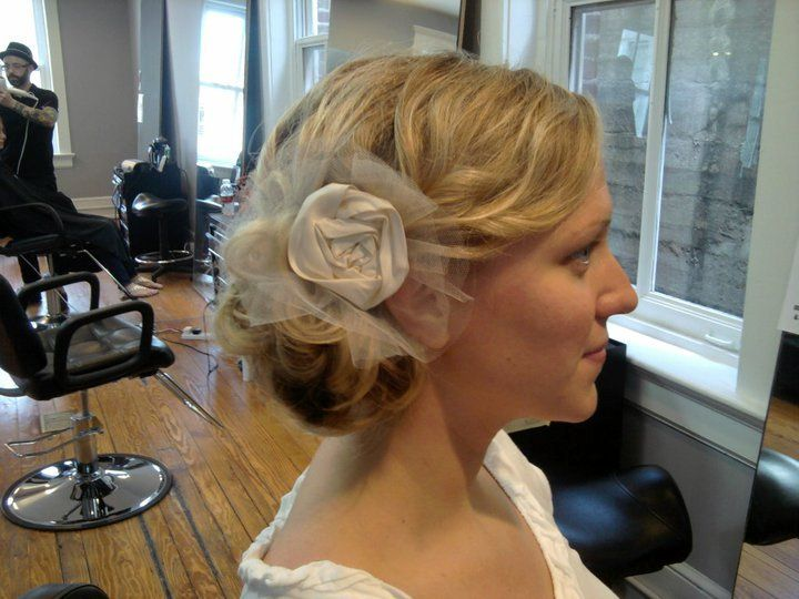 Side bun with lace hair accessory