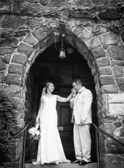 Roycroft Couple standing outside The Royroft Chapel.