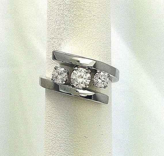 classic three diamond engagement ring