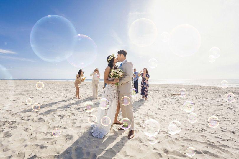 Beach Wedding Bubbles Kiss