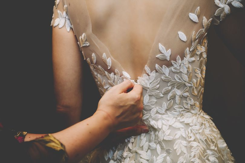 Wearing the wedding gown