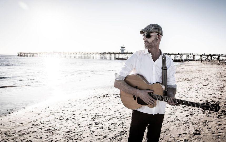 Solo acoustic beach wedding