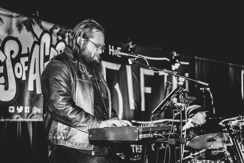 Tim on keys and saxophone