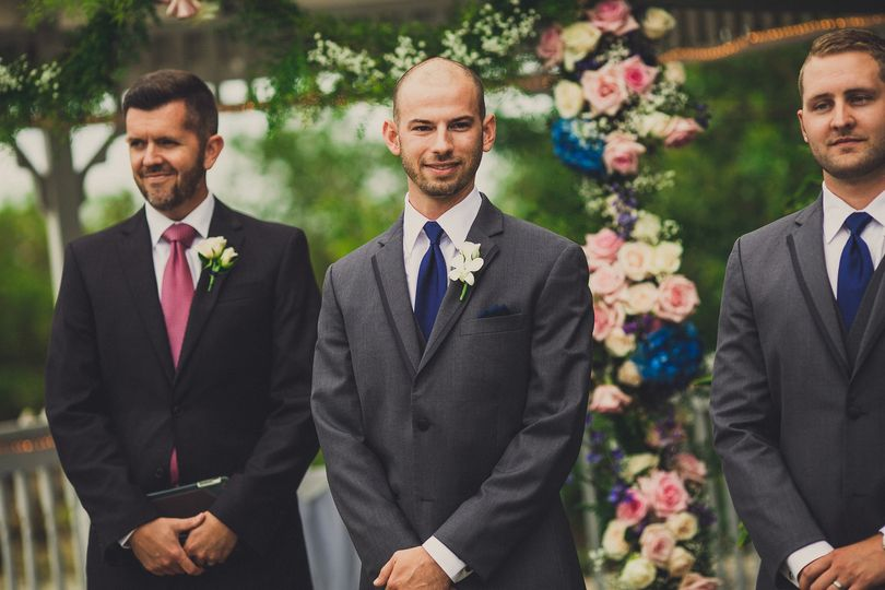 Officiant, groom and groomsman