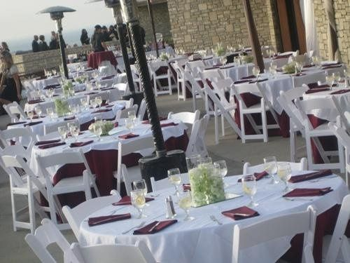 outdoors, ocean view, centerpieces, linens, white wood chairs