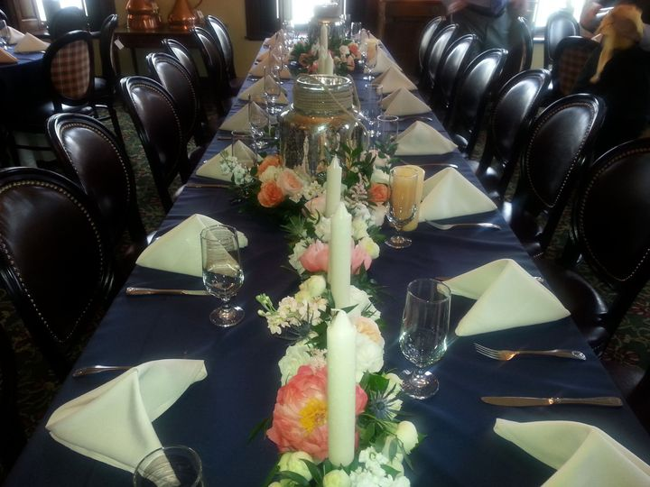 Navy and Ivory linens with beautiful floral centerpieces