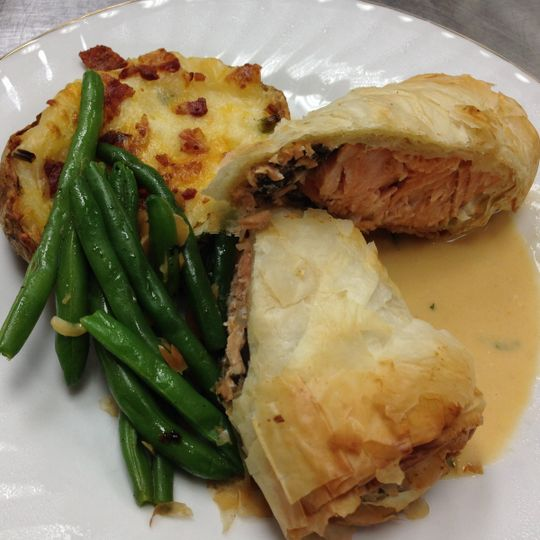 Salmon and wild mushroom encroute with a lobster cognac sauce