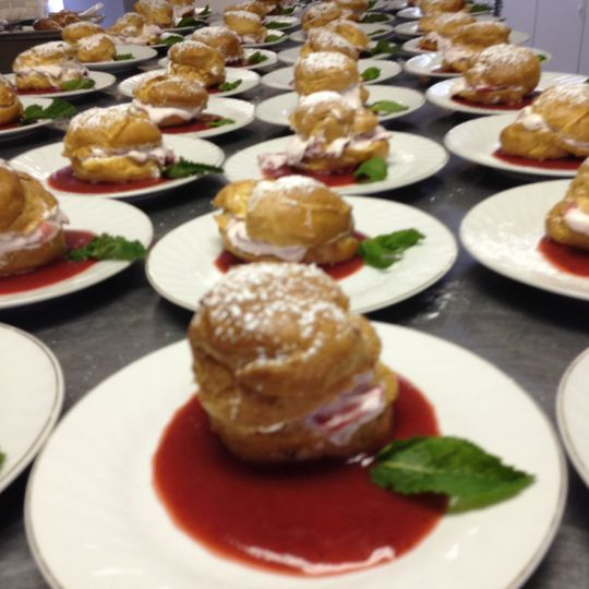 Strawberry cream puff with a fresh strawberry sauce