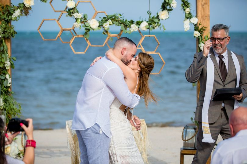 Boho chic beachside ceremony featuring our Valerie structure