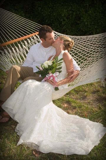 Beach Wedding kissing in hammock