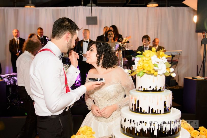 800x800 1498184772878 0963ash with bride  groom cake