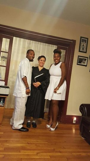 Officiant photo with the couple
