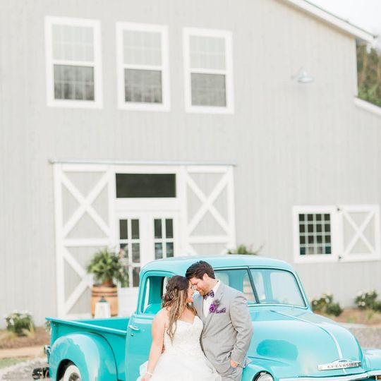The Establishment Barn - newlyweds with vintage car