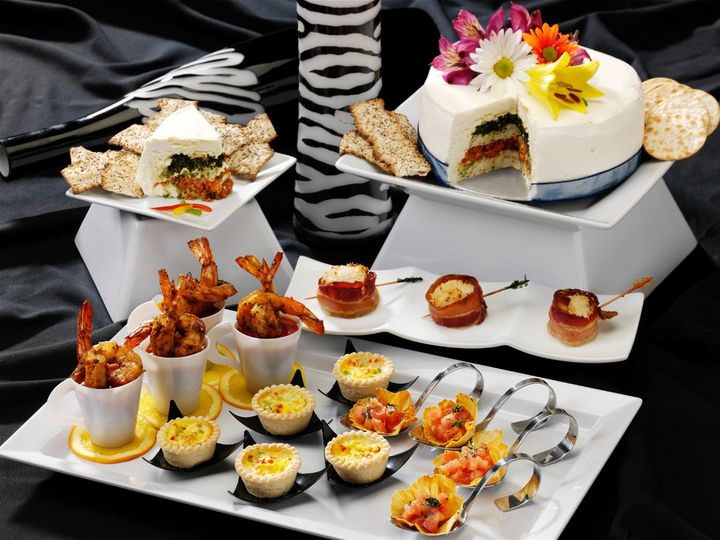 Classic Hors d'oeuvres including Miniature Quiche, Jumbo Shrimp Cocktail, Pineapple Flowers filled...