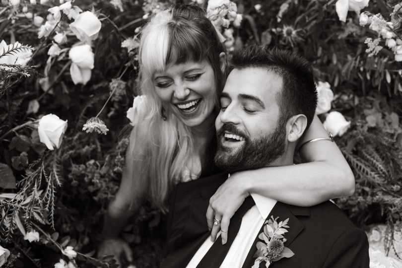 Couple laughing in flowers