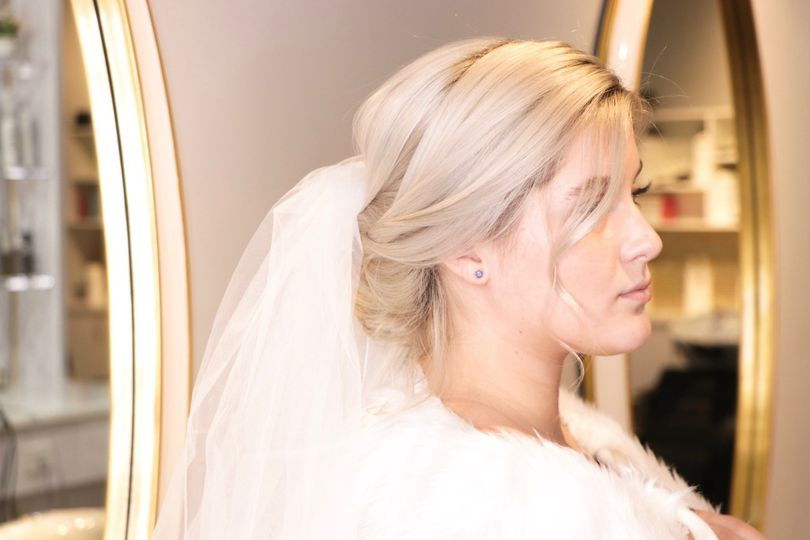 Chignon updo with veil