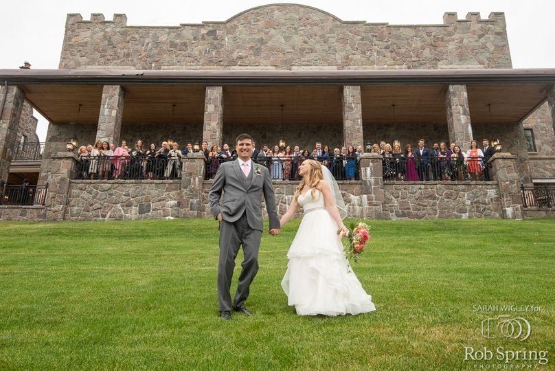 Newlyweds and their guests behind