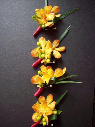 orange vanda orchids, green hypericum, lilies grass finished with burgundy satin.